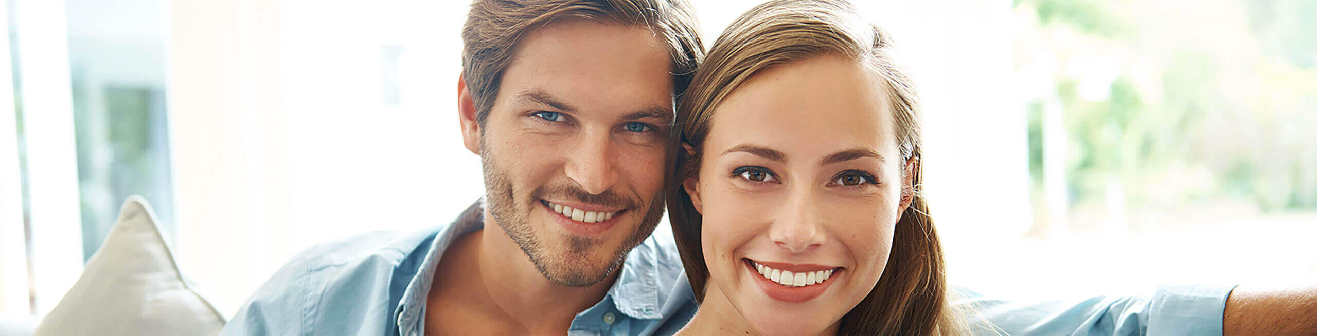 Woman with her husband after cosmetic dentistry services
