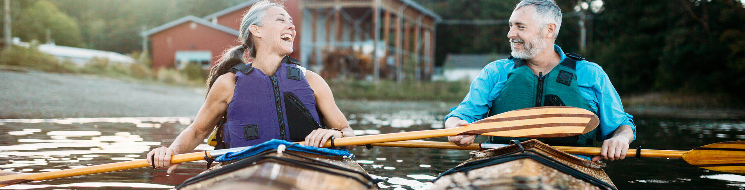 couple kayaking down a river together